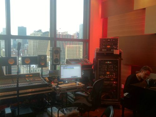 """In a recording studio, with a beautiful view of the city. What are we doing?"" (Source: Depche Mode)"