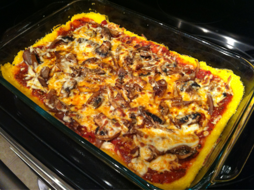 "A play off of Forks Over Knives' ""Plant Powered Polenta Pizza""… I added onion, mushroom, and cheese… I had some left from before the diet change and thought I would use it up! :)"