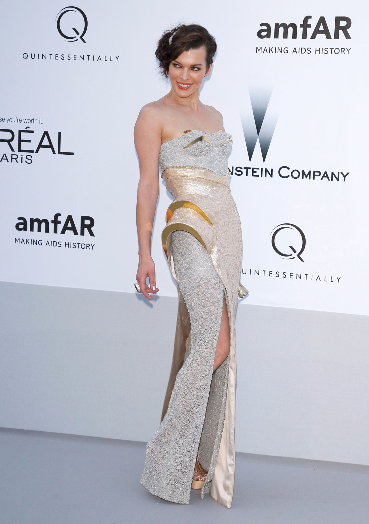 Milla Jovovich in Versace at amfAR's Cinema Against AIDS, May 24th