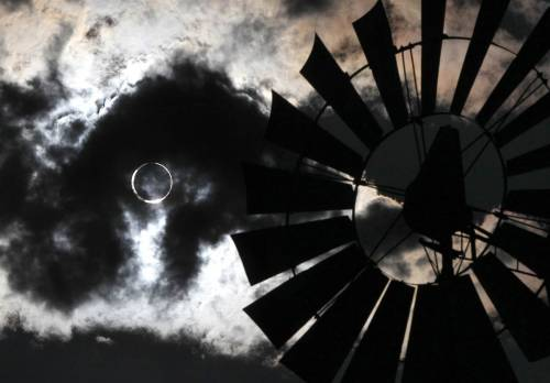 """A thundershower rolls through as a solar eclipse appears in Gardnerville, Nev., on May 20. The annular eclipse, in which the moon passes in front of the sun and leaves only a golden ring around its edges, was visible from Asia to the western United States."""