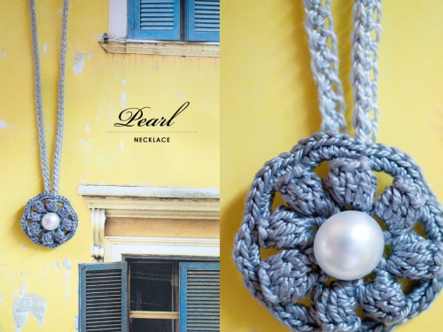 {made} — Pearl Necklace. Crocheted up an adorable little necklace for a birthday present, might be making more of these! I used this pattern, but made the brooch eight pedals instead of six, and put a loop on the back to thread a necklace chain through using a single crochet foundation stitch. The chain also uses a single crochet foundation row with ch 8 in the middle to help hold the petal in the center. I put a metal clasp to close.