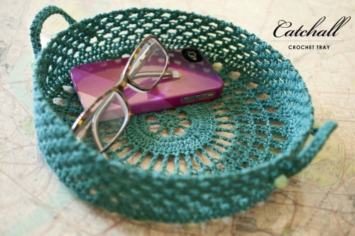 {made} — Catchall Crochet Tray. Wildfiber yarn shop had a crochet doily swap May 2012 and I wanted to do something a little out of the ordinary for it. I was inspired by this basket/tray, but wanted it to be much fancier. So, I designed my own version of the pattern and used a homemade starch to stiffen the tray; directions can be found online here.