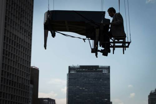 """Brazilian pianist Ricardo de Castro Monteiro plays a piano hanging from wires during the annual Virada Cultural event, in Sao Paulo, Brazil, May 6. The cultural party offers 24 hours of uninterrupted attractions in stages around the city, such as music, dance, cooking, theatre and art and history exhibitions."""