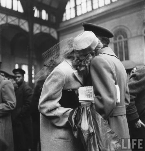 onlyoldphotography:  Alfred Eisenstaedt: Couple in Penn Station sharing farewell embrace before he ships off to war during WWII, 1943