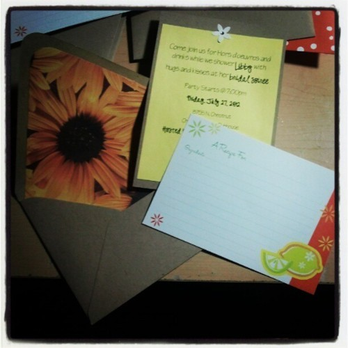 I just finished making the handmade bridal shower invitations. That sunflower print? PAPER GLUED IN TO LINE IT. How cute is that? Bride's idea, so sweet.