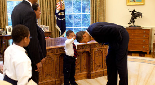 "presidentobamawithbabies: When the pictures were taken and the family was about to leave, Mr. Philadelphia told Mr. Obama that his sons each had a question. In interviews, he and his wife, Roseane, said they did not know what the boys would ask… Jacob spoke first. ""I want to know if my hair is just like yours,"" he told Mr. Obama, so quietly that the president asked him to speak again. Jacob did, and Mr. Obama replied, ""Why don't you touch it and see for yourself?"" He lowered his head, level with Jacob, who hesitated. ""Touch it, dude!"" Mr. Obama said. As Jacob patted the presidential crown, Mr. Souza [the White House photographer] snapped. ""So, what do you think?"" Mr. Obama asked. ""Yes, it does feel the same,"" Jacob said. …A copy of the photo hangs in the Philadelphia family's living room with several others taken that day. Mr. Philadelphia, now in Afghanistan for the State Department, said: ""It's important for black children to see a black man as president. You can believe that any position is possible to achieve if you see a black person in it."""