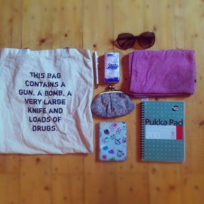 hannahhayley:  What's in my bag photo just because I'm excited about towel day. It's a tea towel because it's all I could find that would fit in my bag but I think it still counts.  That is a very nice bag you got there.