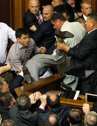 This scene makes events in the British parliament seem somewhat sedate in comparison, with Ukrainian deputies scuffling in the Kiev chamber. What were they fighting about? The basics of language policy, reportedly Photograph: Reuters