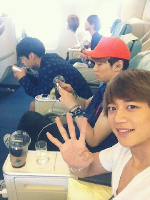 "supershineeshidae:  120525 Me2day Update - Minho    [민호] 우리 오늘 네살이넹       ""Today is our 4th year."" Credit: SHINee's me2day       Trans by : Forever_SHINee     GOD BLESS THESE BOYS.  omg look at them…phones and sleepy faces/bodies and what looks to be an empty huge cup of coffee or frap or something… it's like ""it's amazing we're alive! happy 4 years!"" Gah minho you cutie pie you…"