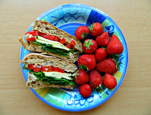 thefitty:  lovelyandfit:  GF Seeded brown roll with hummus, romaine lettuce, zucchini slices, and red peppers with a side of strawberries.  (via imgTumble)