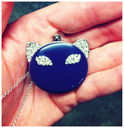 Katy Perry 'Purrr' perfume in a cat necklace.