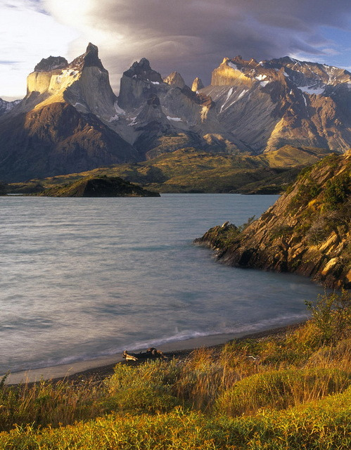 visitheworld:  Lenticular clouds at sunset over the Cuernos del Paine from the shore of Lago Pehoe, Chile (by craigwhitmore).
