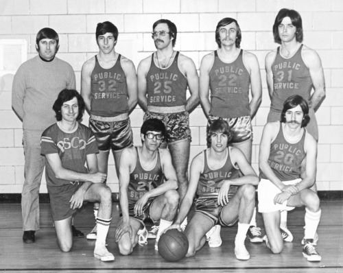 Who Says Linemen Can't Jump? (c. 1970s) The PSNH employee basketball team poses for a group shot. Exact year unknown, but from those uniforms, we're guessing sometime in the '70s. Top Row: Frank Swierz, Barry Dudka, Joe Stazowski, George St. John, Frank Manning. Bottom Row: Tom Rasza, Tom Katsikas, Bob Heaton, Phil St. Laurent. 2012-05-30: According to Bob Heaton (#24), #25 is Joe Stazowski. 2012-05-25: #25 (middle of top row)was mistakenly reported as being Dana Flanders. (Sorry!) If you happen to know the name of player #25, please let us know using the link below.