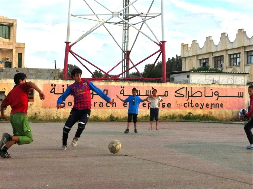 """Sonatrach, Entreprise Citoyenne""     Kids playing football in Les Eucalyptus, nears Algiers"