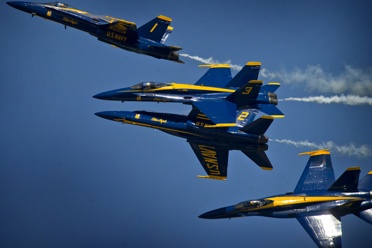 Image description: The Blue Angels, the U.S. Navy flight demonstration squadron, demonstrates choreographed flight skills during the annual Joint Service Open House at Andrews Air Force Base near Washington, DC. Photo by Todd Frantom, U.S. Navy