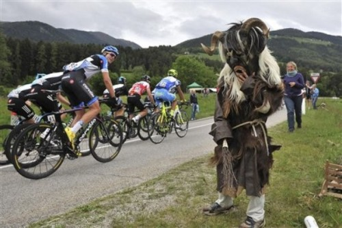 fuckyeahcycling:  Cyclists pedal by a supporter with a weird costume during the 16th stage of the Giro d'Italia, Tour of Italy cycling race, from Limone sul Garda to Falzes - Pfalzen, Italy, Tuesday, May 22, 2012. (via Photo from AP Photo)