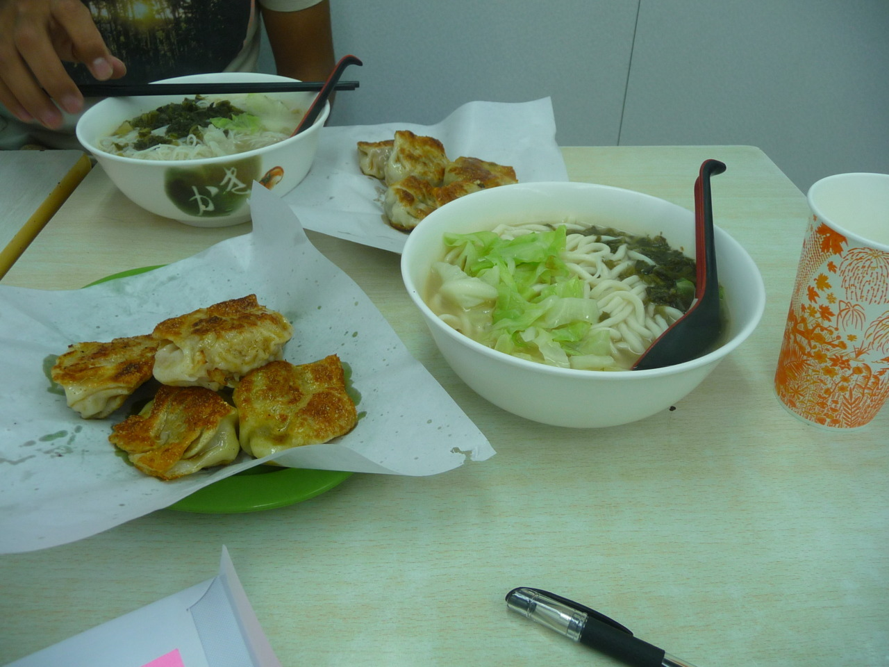 Bowl of noodle soup, 4 dumplings any way you want 'em and homemade soy milk = $21 HKD! It was delicious.
