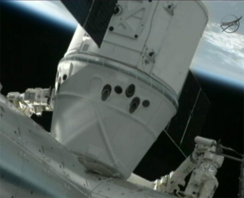 This is BIG!  -  discoverynews:  Dragon Capsule Berthed at Space Station Astronauts aboard the International Space Station tucked the newly arrived Dragon cargo capsule into a berthing port on the Harmony connecting node just after noon on Friday, capping a key test flight for NASA's new commercial space initiative. The capsule, owned by Space Exploration Technologies, or SpaceX, is the first privately owned vessel to reach the orbital outpost, which flies about 240 miles above Earth. keep reading