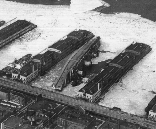 Normandie, renamed USS Lafayette, lies capsized in the frozen mud of her New York Pier, 22 February 1942.