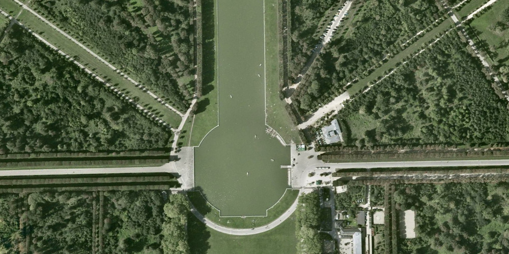 "LAND+CITY+URBAN+SCAPE | 710 | VERSAILLES | FRANCE | GOOGLE EARTH The first building campaign (1664–1668) commenced with the Plaisirs de l'Île enchantée of 1664, a fête that was held between 7 and 13 May 1664. The first building campaign (1664–1668) involved alterations in the château and gardens to accommodate the 600 guests invited to the party. (Nolhac, 1899, 1901; Marie, 1968; Verlet, 1985) The second building campaign (1669–1672) was inaugurated with the signing of the Treaty of Aix-la-Chapelle, which ended the War of Devolution. During this campaign, the château began to assume some of the appearance that it has today. The most important modification of the château was Le Vau's envelope of Louis XIII's hunting lodge. (Nolhac, 1901; Marie, 1972; Verlet, 1985) Significant to the design and construction of the grands appartements is that the rooms of both apartments are of the same configuration and dimensions – a hitherto unprecedented feature in French palace design. Both thegrand appartement du roi and the grand appartement de la reine formed a suite of seven enfilade rooms. The decoration of the rooms, which was conducted under Le Brun's direction, depicted the ""heroic actions of the king"" and were represented in allegorical form by the actions of historical figures from the antique past (Alexander the Great, Augustus, Cyrus, etc.). (Berger, 1986; Félibien, 1674; Verlet, 1985) With the signing of the Treaty of Nijmegen in 1678, which ended the Dutch War, the third building campaign at Versailles began (1678–1684). Under the direction of the architect, Jules Hardouin-Mansart, the Palace of Versailles acquired much of the look that it has today. In addition to the Hall of Mirrors, Hardouin-Mansart designed the north and south wings and the Orangerie. Le Brun was occupied not only with the interior decoration of the new additions of the palace, but also collaborated with Le Nôtre's in landscaping the palace gardens (Berger, 1985; Thompson, 2006; Verlet, 1985). Soon after the defeat of the War of the League of Augsburg (1688–1697), Louis XIV undertook his last building campaign at Versailles. The fourth building campaign (1699–1710) concentrated almost exclusively on construction of the royal chapel designed by Hardouin-Mansart and finished by Robert de Cotte. There were also some modifications in the appartement du roi, namely the construction of the Salon de l'Œil de Bœuf and the King's Bedchamber. With the completion of the chapel in 1710, virtually all construction at Versailles ceased; building would not be resumed at Versailles until some twenty one years later during the reign of Louis XV (Nolhac, 1911; Marie, 1976, 1984; Verlet, 1985)."