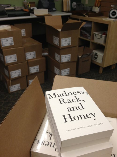 "The finished copies of Mary Ruefle's Madness, Rack, and Honey: Collected Lectures arrived at the office. Lots of squealing was involved. We had a brainstorming session of what it felt like to hold. ""Excalibur"" and ""a burger"" were mentioned."