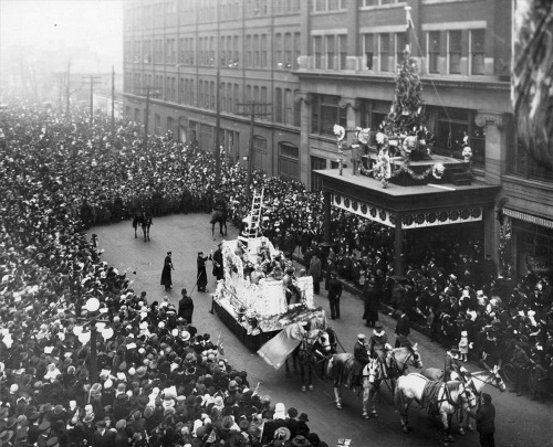 The Eaton's Santa Claus Parade on James Street, 1918, Toronto, Ontario, Canada. At the end of the parade, Santa would climb from his float up a ladder into the Eaton's department store. Source: Archives of Ontario