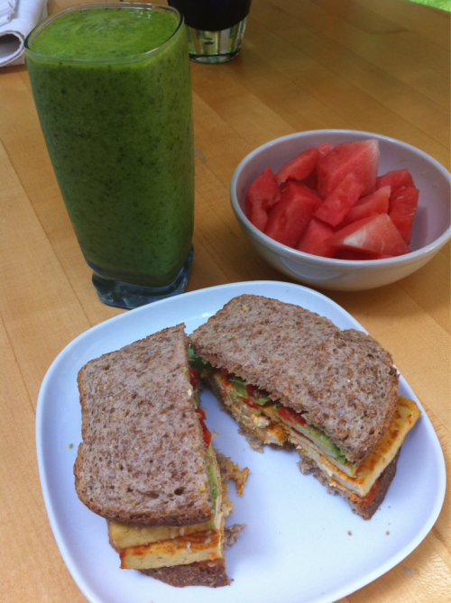 Late lunch; Sriracha Tofu, Hummus, Avocado & Red Peppers on Ezekiel Bread Banana, Mango & Aloe Green Smoothie Watermelon!