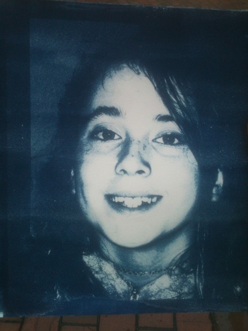 Cyanotype of a photo of Natalie. Done for my artist book class.