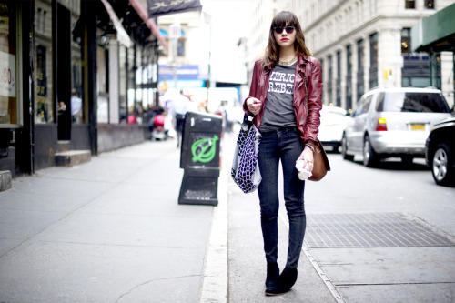 maybelline:  She's a rebel with a fashion cause.  A maroon jacket and unexpected accessories show her quirky side. Her lipstick keeps this look pretty in pink.