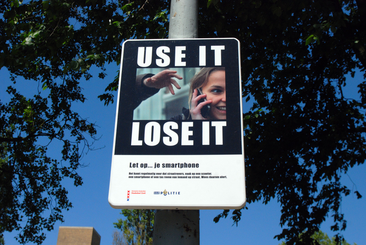 Useless streetsign, warns people for smartphonetheft by motorscooterists, found in Amsterdam, Rivierenbuurt, 2012