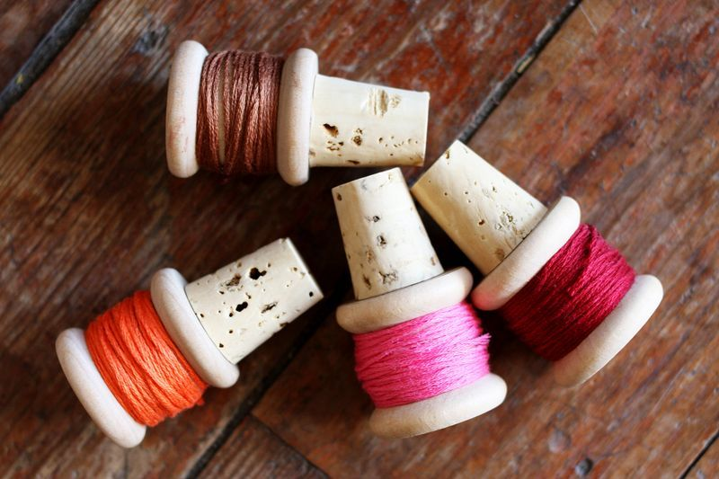 DIY Thursdays: Thread Spool Wine Stops There's nothing like savouring a top notch bottle of wine. To keep your hooch sealed, the perfect wine stop is in order! We found this adorable project from A Beautiful Mess + can't wait to try it this weekend. Full directions, here. We have a thing for wine stops, check out our porcelain anchor edition. (Photos via: A Beautiful Mess)