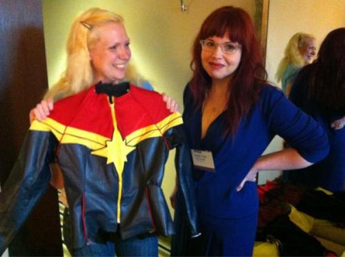"kellysue:  So… trip to #Wiscon36? TOTALLY MADE.  I think we both got teary.   And I gave her the pilots wings I'd been carrying around for this very occasion.   Dream: realized.  So this is me ;) My husband made the jacket; we will take detailed pictures when it is complete and I will blog the whole process and story. This moment was the realization of a dream for me, too. I wanted to show Kelly Sue (and her collaborators) how much this character and this project mean to me and I believe I succeeded. She'd already convinced me she ""gets it"" in interviews I've read since the announcement of Captain Marvel, but in the discussions we had at Wiscon, and in the work I got to preview, it became clear when it comes to Carol Danvers, I get Kelly Sue and Kelly Sue gets me. Here are my wings:   I feel they're a symbol that we're all flying together."