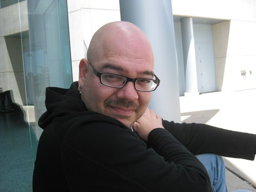 "thedailywhat:  Weekend Read: Comic book writer and novelist Greg Rucka (Stumptown, Queen and Country) answers a frequently asked question in an incisive essay for io9 titled ""Why I Write 'Strong Female Characters'"". The entire piece is well worth a read, but here's the key passage:  Writers don't write Men or Women or Dogs or Salmon. Writers write characters, and at our best, if we do it well and with care and with thought, we invest in those characters a spark of life, a realism and nuance that makes them believable and relatable.  Rucka also questions why journalists don't tend to ask female writers how they write ""strong female characters,"" and why more male writers don't do the research about their female characters, the way they would with any other character whose experience differs from their own. [io9]  Do yourself a favor and Read every ""Queen & Country"" trade paperback.  Tara Chace for life, sucka (Rucka)!"