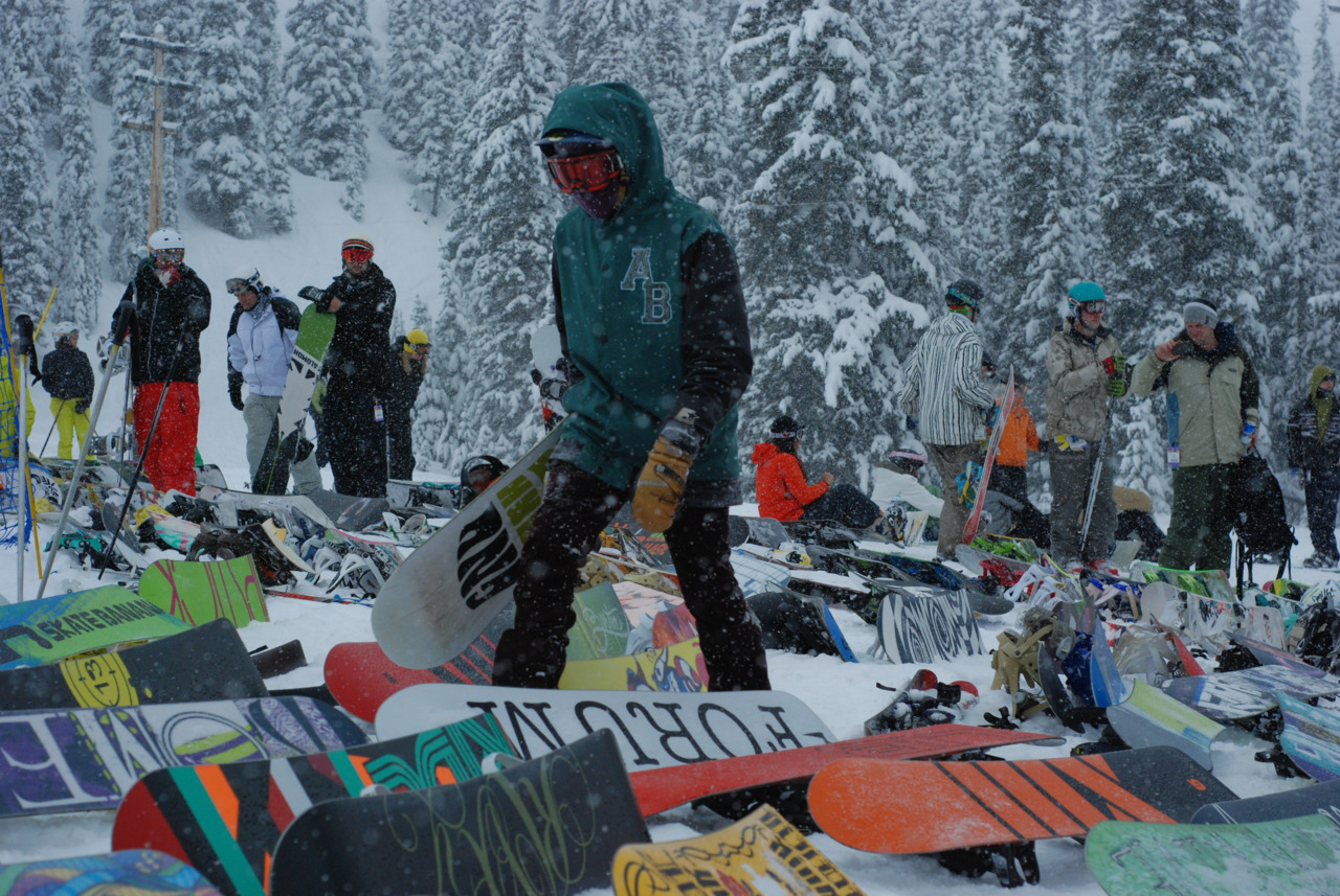 Some dude walking through a sea of boards, taken sometime this season at Marmot Basin