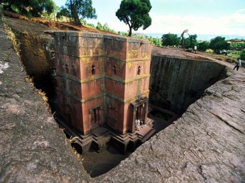 nezua:  wondersofafrica:  (by Philippe Bourseiller) Lalibela Church, Ethiopia  The town of Lalibela in northern Ethiopia is renowned for 12 Christian churches that were hewed out of solid stone some 800 years ago. The most stunning is Bieta Giyorgis, shown here, a massive monolith 40 feet (12 meters) tall, intricately carved and shaped like a cross.   amazing. these are the kinds of things that make me feel somewhat jazzed up about humankind once in a while.