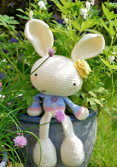 "Our Travel Log! May 25, 2012. United Kingdom. ""My Spring Bunny is finished and sitting in the garden enjoying the sunshine! Big thanks to A Morning Cup of Jo Creations for such a great pattern :)"" — Catherine Houston(Spring Bunny crocheted by Catherine.  Pattern can be found on Craftsy.) .YAY!!!  THIS IS AMAZING!  Catherine is the first to post a photo of her finished bunny!  I love the colors she chose for her sweater. :)  Can't wait to see more amigurumi bunnies around the world! <3 Josephine @ A Morning Cup of Jo Creations  (Facebook, Tumblr, Etsy, Craftsy)"
