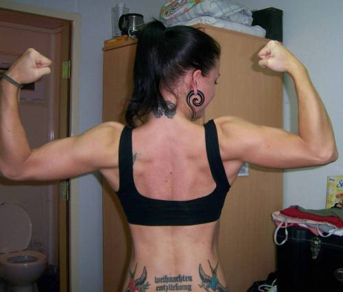 crossfitandfitgirls:  Christmas Abbott with some awesome back tats. And cool/enormous earrings.