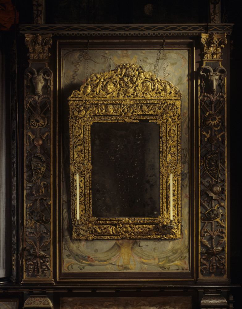Late-seventeenth-century mirror, its ebonised frame inlaid with pierced gilt brass chased with acanthus patterns, one of a pair, probably English, in the Cartoon Gallery at Knole. The pilasters with grotesque decoration are topped by ram's masks, the old crest of the Sackville family. ©National Trust Images/Andreas von Einsiedel via