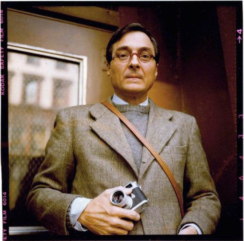 Thinking of Fall This portrait of William Eggleston, shot by Maude Schuyler Clay, embodies everything that's beautiful about fall. Notice the 3/2 roll tweed with faint overpane check; the light blue, candy striped OCBD; and the grey crewneck sweater, most likely made from a hairy Shetland wool. These three fabrics - tweed, oxford cotton, and Shetland wool - pair well in their roughness, giving the ensemble a nicely tailored, but still casual, look. Below he could be wearing something equally textured and casual, such as dark chocolate brown corduroys with suede chukka boots, or perhaps a heavy pair of khaki chinos, ones where the diagonal weave is easily visible, and some shell cordovan wingtips. This to me is fall.  Oh, and the faux-tortiseshell glasses are a nice touch. Something I've been wanting for a bugger long time.