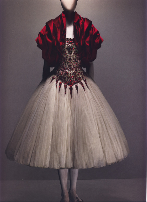 "Ensemble, The Girl Who Lived in the Tree Dress of ivory silk tulle embroidered with red glass crystals; bolero of red silk Photographed by Sølve Sundsbø for Alexander McQueen: Savage Beauty ""[In this collection] she was a feral creature living in the tree. When she decided to descend to earth, she was transformed into a princess."""