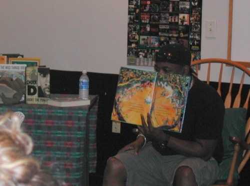 "Chuck D reads ""Giraffes Can't Dance"" to the kids."