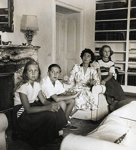 1954, Athens, Greece —- Queen Frederica of Greece sits with her children, Constantine, Irini, and Sophia. Constantine later ruled Greece as King from 1964 to 1974, and Sophia married King Juan Carlos of Spain. —- Image by © Genevieve Naylor/CORBIS
