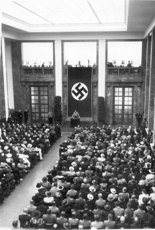 a-tychiphobia:  Adolf Hitler speaking at the opening of the House of German Art, Munich, Germany - Jul 18, 1937