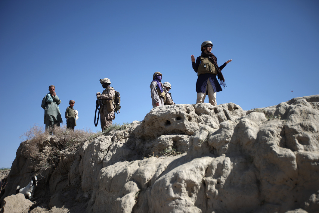 An aid worker stands lost on top of an embankment along the Helmand River during a foot patrol to find a site to be reinforced for a local farmer during the height of the civilian surge. Photo: John Wendle The war in Afghanistan is not over. Help us tell the story. Fund our Kickstarter.