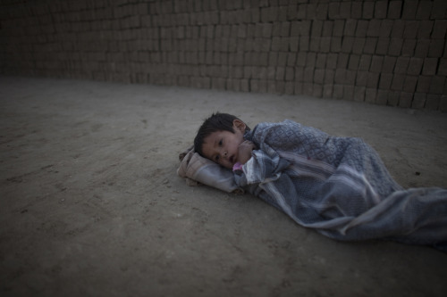 A child laborer rests as laborers stack bricks at a brick factory in Kabul. Photo: Jonathan Saruk The war in Afghanistan is not over. Help us tell the story. Fund our Kickstarter.