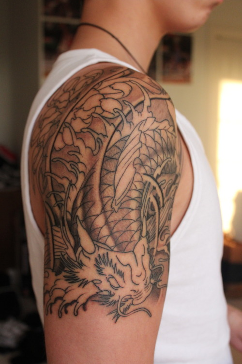 fuckyeahtattoos:  This is my first tattoo. It's half Japanese koi fish and half dragon. I've always been fascinated by this style of art and I just loved the story behind the koi fish. I got this at Chronic Ink in Toronto. Just one more session and it should be done.