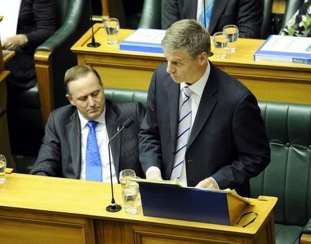 John Key looks at English.