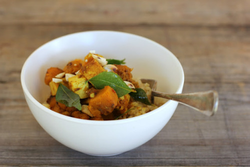 Pumpkin Tofu Curry serves 4 with rice 3 tablespoons virgin coconut oil, ghee or rice bran oil 1 teaspoon black mustard seeds 1 teaspoon cumin seeds 2 stems curry leaves, leaves picked and stems discarded 500g pumpkin (butternut, crown, Japanese or Queensland blue), peeled, seeded, cut into 1cm cubes (approx 2-3 cups once diced) 320g packet of extra firm tofu, cut into 1cm cubes 1 teaspoon ground cumin 1 teaspoon ground coriander 1 teaspoon garam masala 1/2 teaspoon ground turmeric 2 cloves garlic, finely chopped 1-2 long red Thai chillies, seeded and finely chopped sea salt, to taste juice 1/2 lemon, plus wedges to serve 1/2 cup lightly toasted unsalted cashew nuts, roughly chopped, to serve cooked brown rice, to serve Heat coconut oil in a large heavy-based frying pan over medium-high heat. Add black mustard seeds, cumin seeds and curry leaves. Cook, stirring until the mustard seeds start to pop. Add diced pumpkin and tofu and cook, stirring for 1-2 minutes or until everything is coated in the fragrant oil. Add ground spices, garlic and chilli, stir well. Add 1/4 cup (60ml) water and bring to the boil. Cover, reduce heat to a simmer and cook for 6-8 minutes, or until the pumpkin is tender but not too mushy. Season to taste with sea salt, add lemon juice and stir well. Serve hot with brown rice, sprinkled with toasted cashew nuts and a wedge of lemon to squeeze over top if desired.