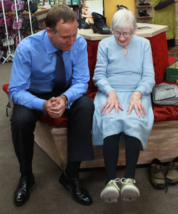 John Key looks at shoes.