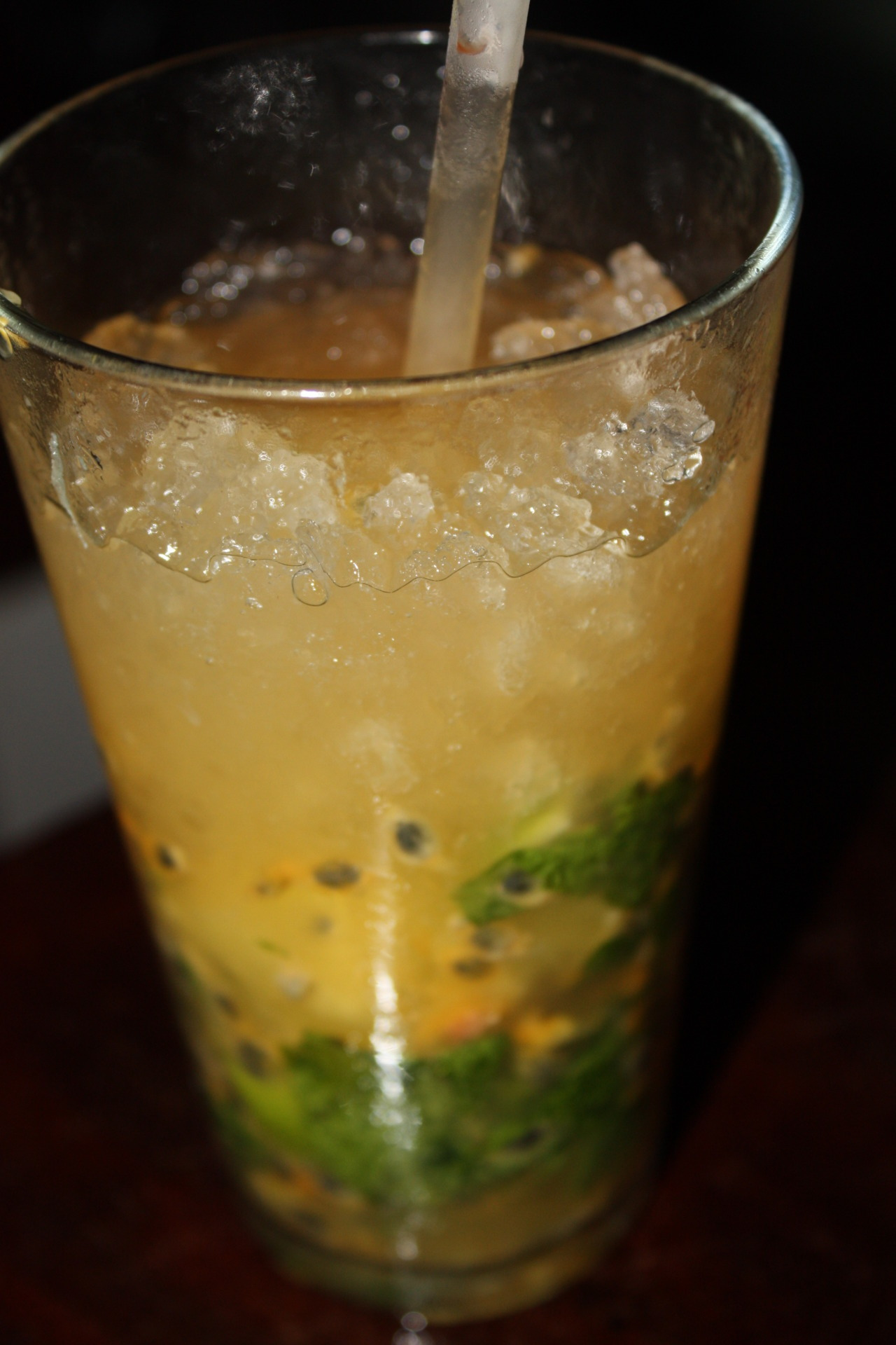 Passion Fruit Mojito Ingredients:1 Spoon White Sugar 2 Oz White Rum (Bambu or Matusalem)Hand full of mint leaves Half of a Lime Cut into 3 Wedges Splash of Club Aoda 1 Oz Passion Fruit (puree or one fresh passion fruit contents)1.5 Oz Sweet and Sour Mix Crushed Ice *Game changer.